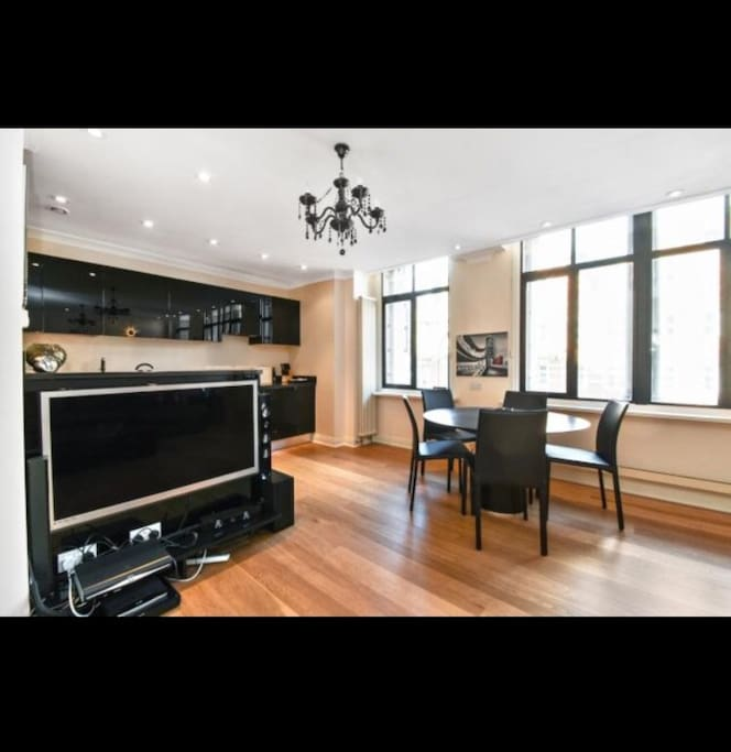Flat Screen TV and Kitchen