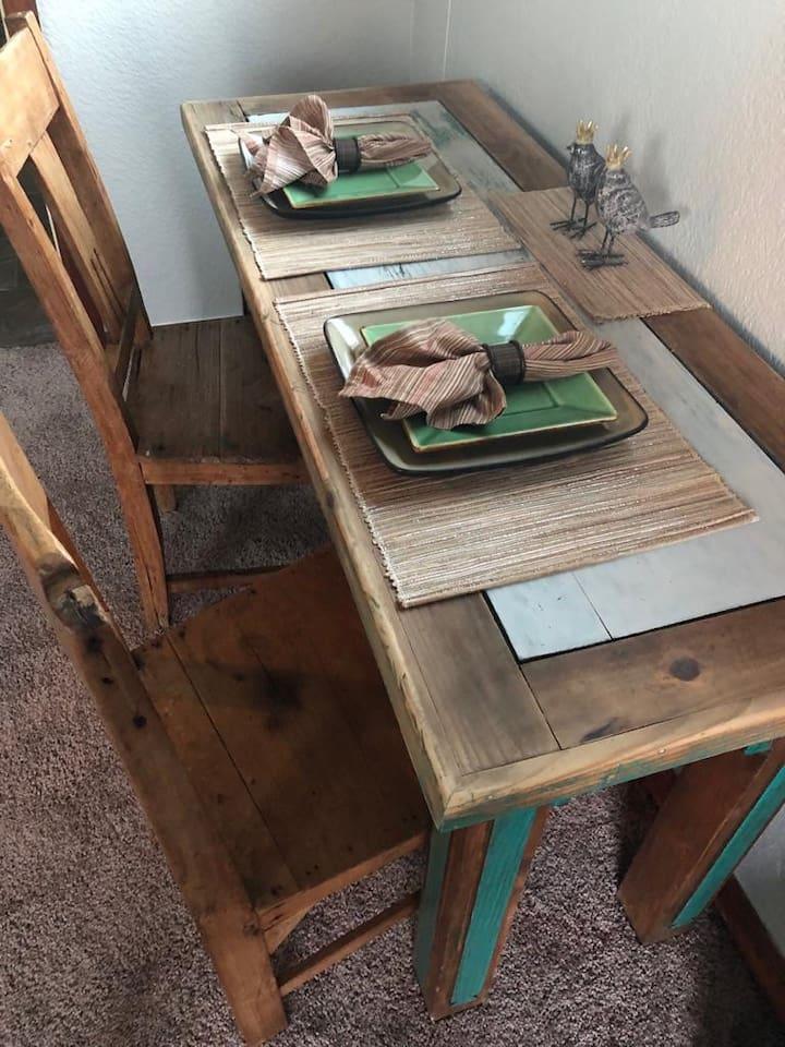 Master bedroom dining table or workspace desk.