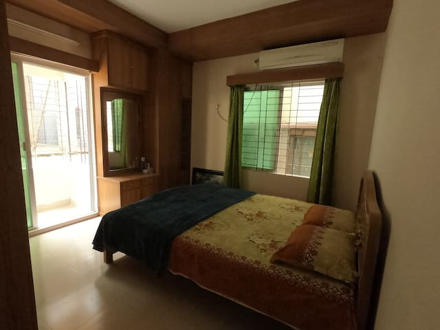 Second Master bedroom with AC, attached toilet,  natural light, a balcony.