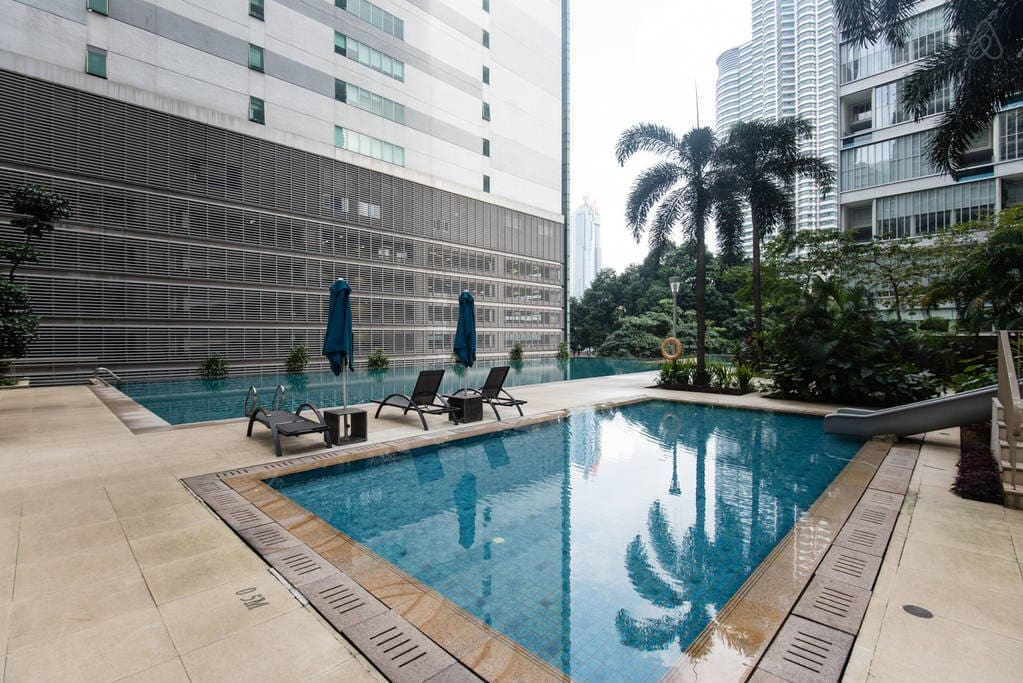 Large swimming pool and children's pool with a view of KLCC