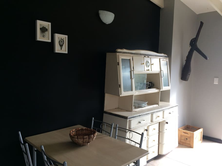 Little sixties cupboard with glasses, cutlery, some games and toys. The clock doesn't work so it's always wine o'clock!