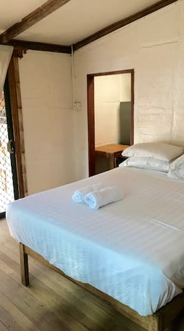 Queen size bed, 4 pillows and mosquito net