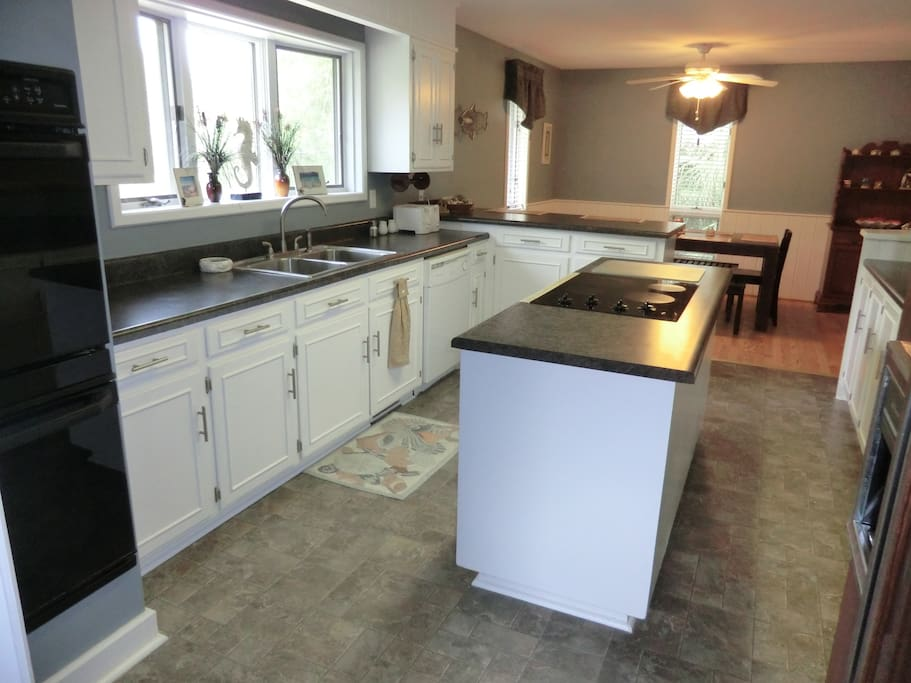 Large Kitchen with double ovens and separate stove
