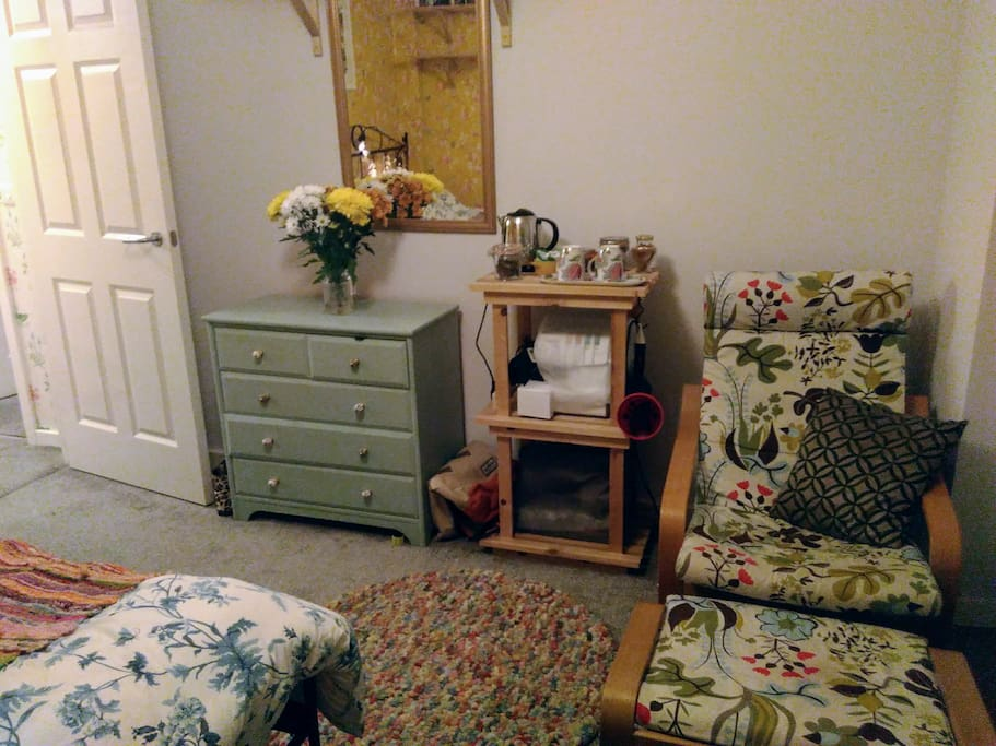 Armchair with footstool in the bedroom.