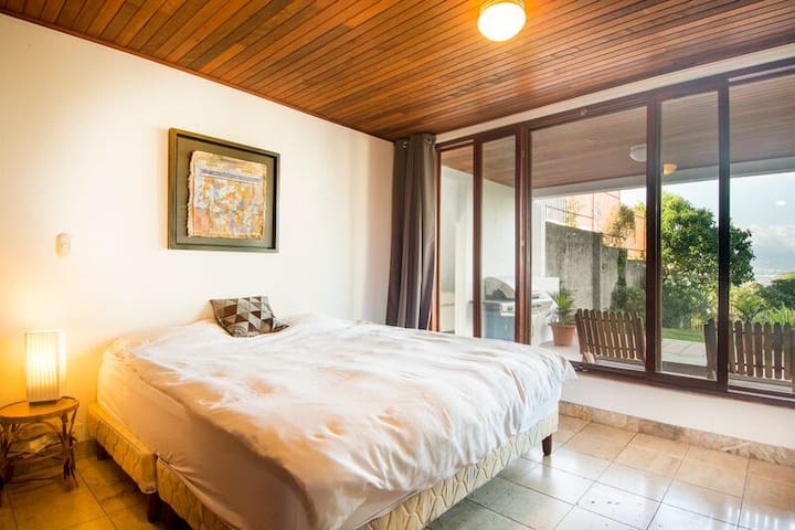 Master bedroom with view to terras /veranda and garden.