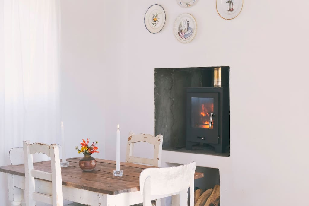table close to the fire place