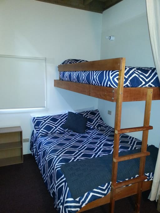 Double and single bed on the landing (Curtains to make area private)