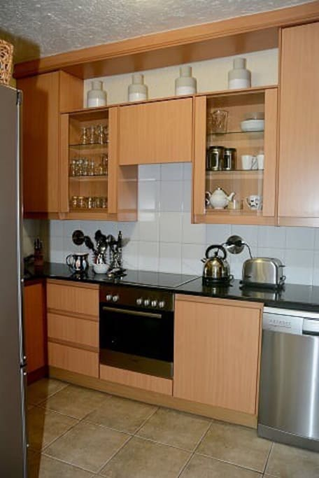 Fully equipped cooks kitchen includes dish washer & washing machine & everything one needs to whip up lovely meals .  Includes basics such as salt & pepper & tea & coffee & milk.