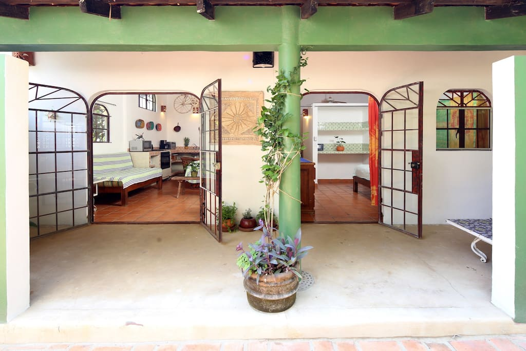 Living area and bedroom open to your private courtyard