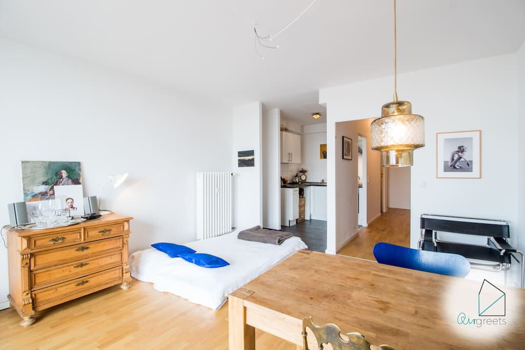 The studio apartment is open designed and offers a dining and sleeping area as well as a modern kitchen.