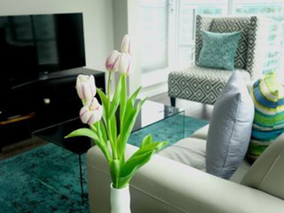 Living space with stylish accent chairs and leather love seat in a bright space
