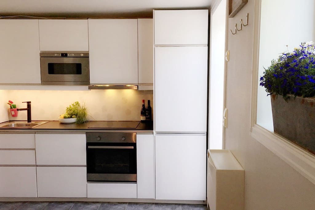 New kitchen, installed in 2015. Microwave, oven, induction-top plates, fan, freezer, fridge - Large freezer/fridge. We provide (1) dishwasher tablet for each day of you stay, and complementary coffee/tea for your breakfasts.