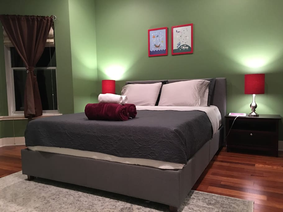 Master bedroom on 2nd floor with brand new queen platform/memory foam mattress and attached bathroom, bay windows overlooking private lush garden.  Eastern facing windows with morning light.