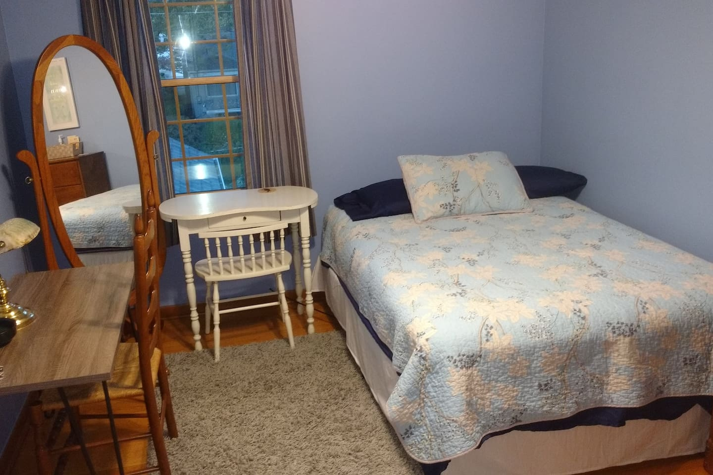 Full double bed, desk, chairs, dresser, closet and ceiling fan.