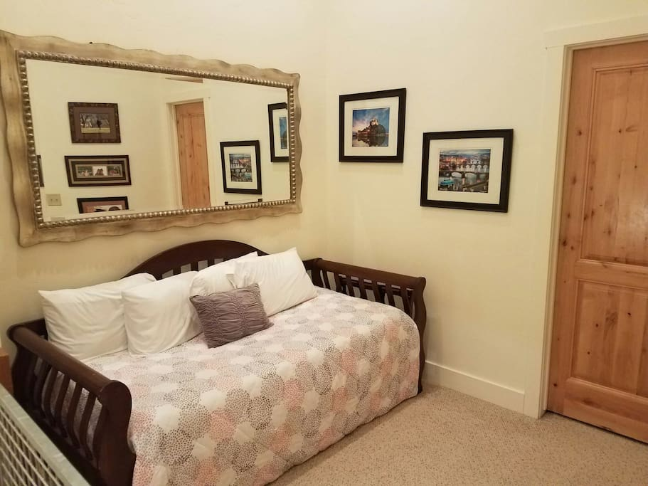 Trundle bed with 2 twin size mattresses in loft area.