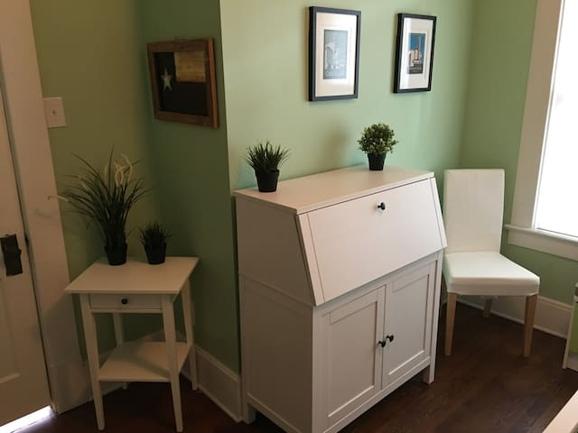 Bedroom Workspace with a fold-down desk and chair.