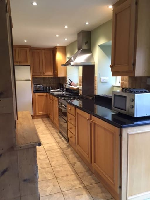 Stag Cottage Kitchen with new granite worktops and new 'SMEG' range oven & hood