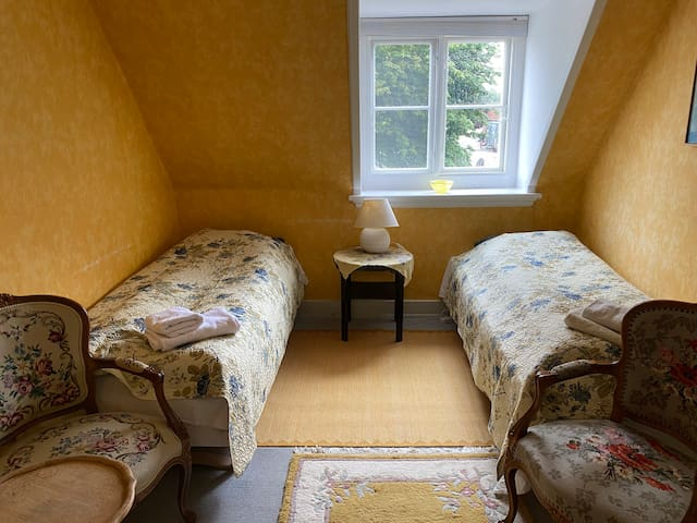 Room 6. Double room, two single beds.
