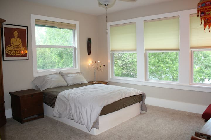 The Treehouse Bedroom offers five windows spanning the treeline, and is truly magical. Firm mattress with a pillow-top, luxury sheets, a feather duvet  and ceiling fan ensure a peaceful slumber.
