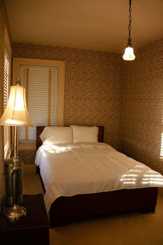 """Original """"little"""" room. Full sized bed."""