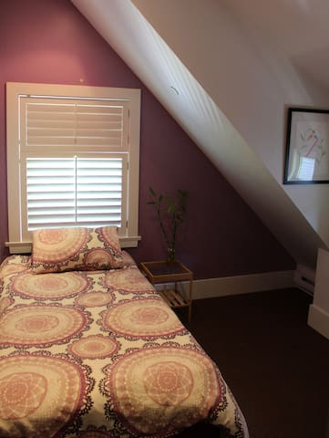 Single room with closet and chest of drawers.