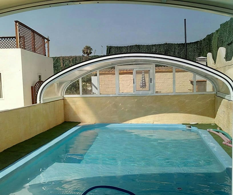 leisure pool in summer with the roof retracted