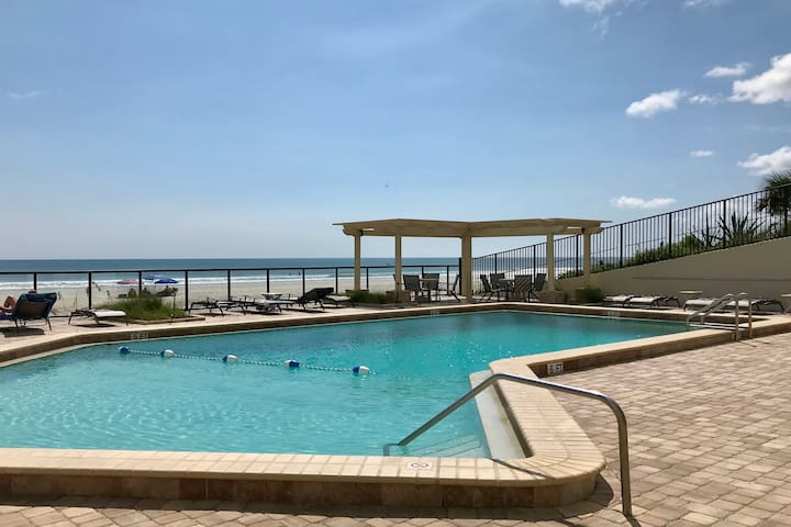 Direct oceanfront condo w/ shared, outdoor pool, hot tub, & fitness room