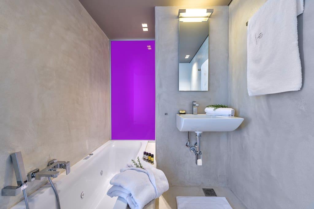 En-suite bathroom with a JACUZZI tub