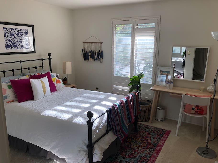 Guest room 1- Queen bed, lots of natural light and overlooks the back patio