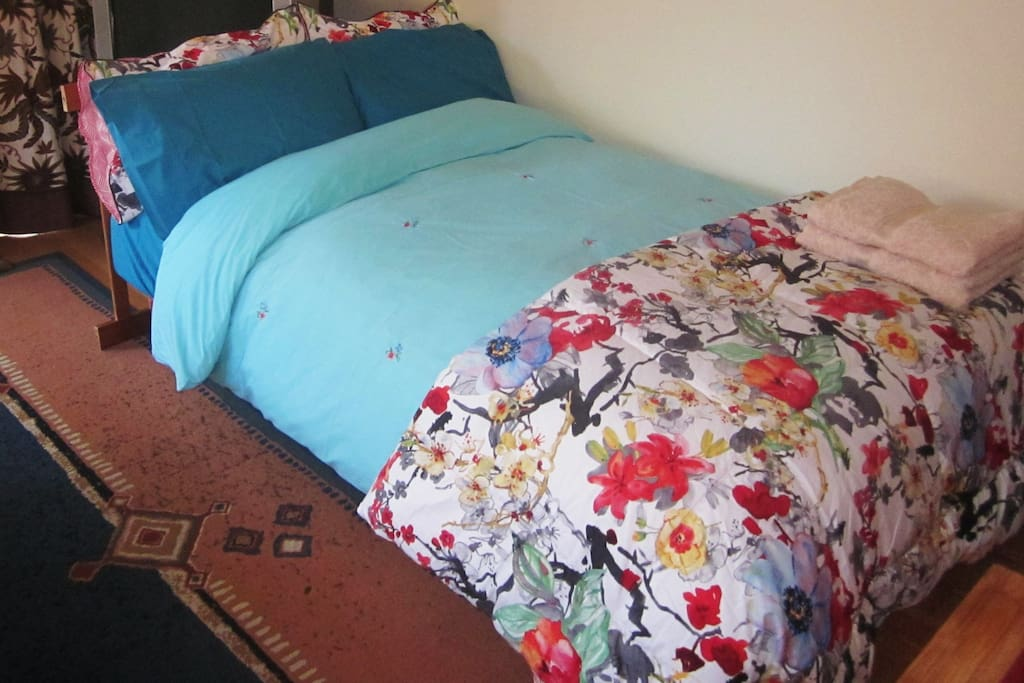Bedroom 2: sofa bed. Curtains, blinds and rugs make the space cosy, warm, give you privacy and make it dark for sleeping.