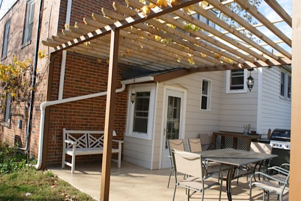 Outdoor patio/pergola includes table, chairs, and propane gas BBQ grill!