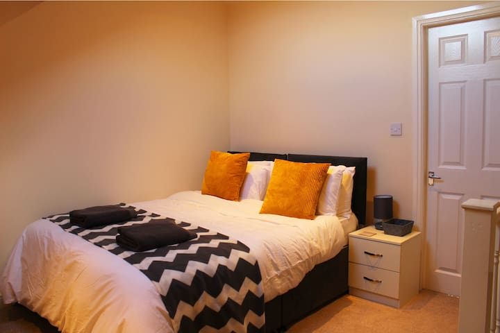 Loft bedroom with large double bed and en suite bathroom.  This room can also be made up as 2 single beds.