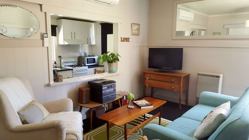 Lounge room with TV, DVD player, movies, stereo record player and complimentary Wi-Fi.