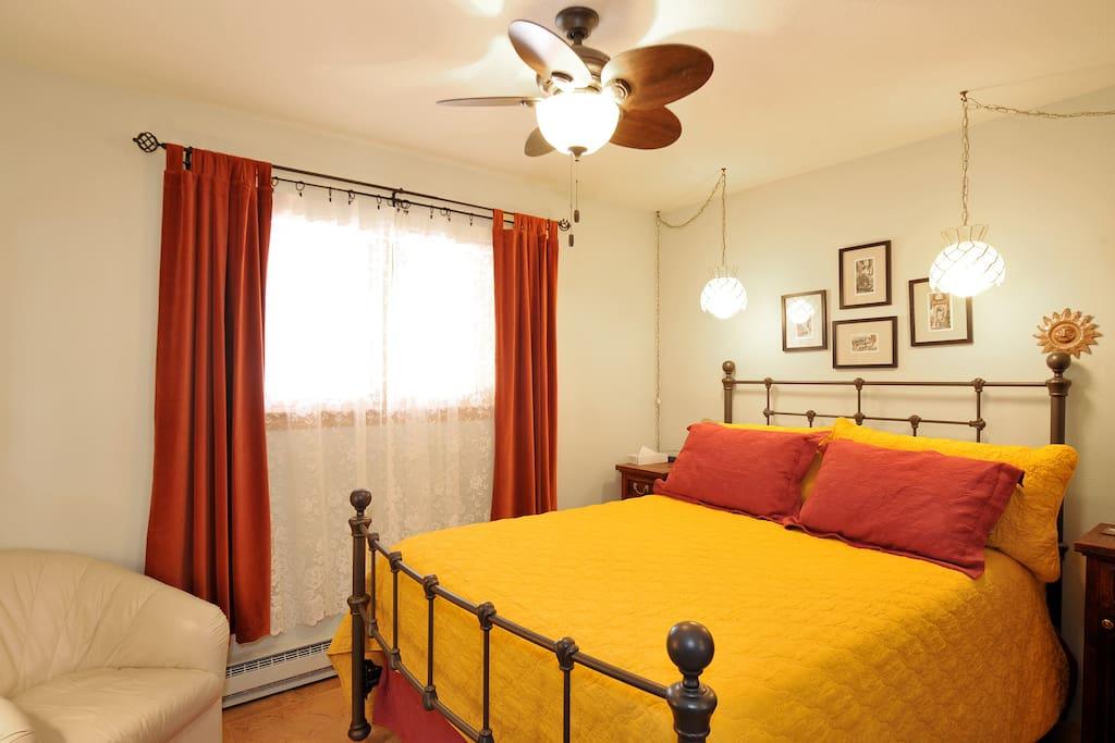Quiet guest bedroom with queen bed.