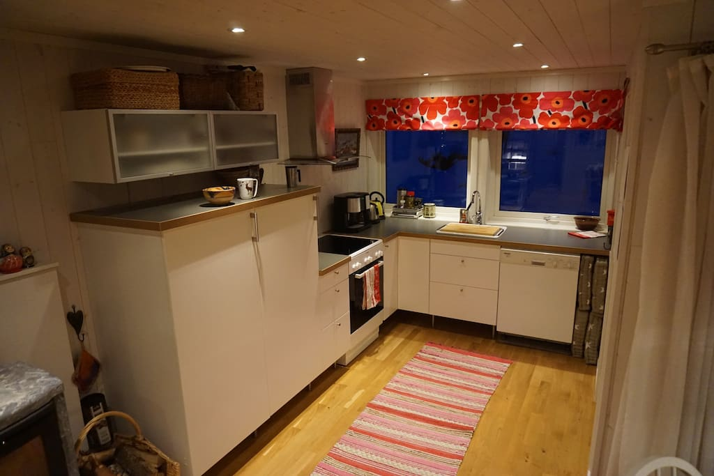 The kitchen includes a fridge, dishwashing machine, stove, etc. All you need for 12 persons.