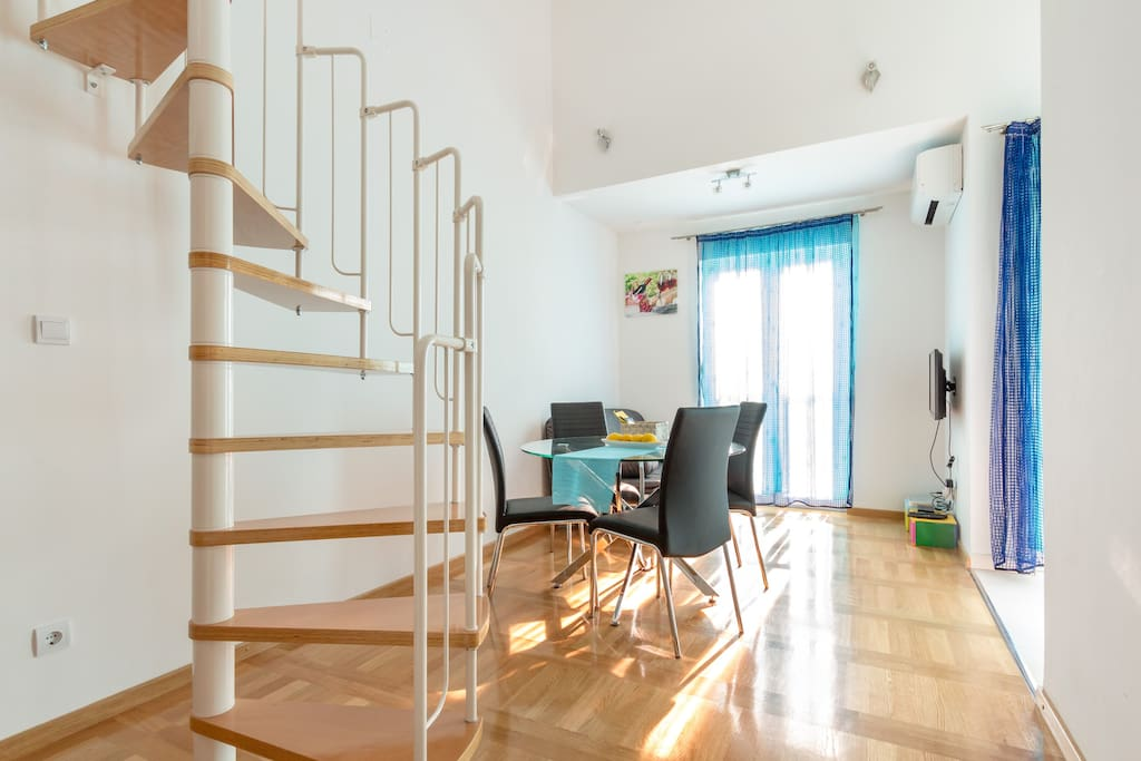 dining room with stairs  to  room