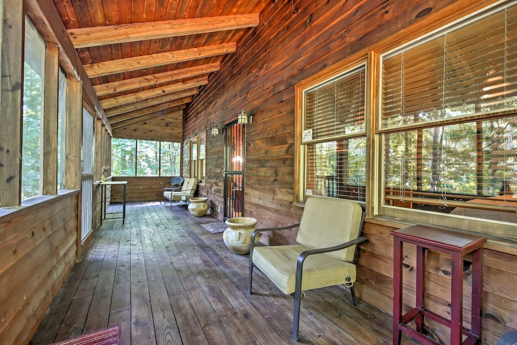 Enjoy a refreshing breeze and a morning cup of coffee on the screened-in deck.