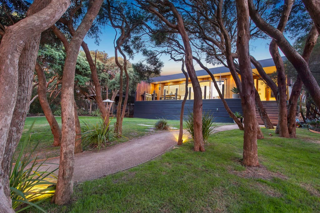 Set in a large fenced garden amongst the ti-trees