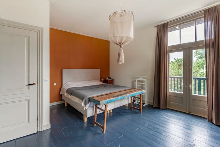 Master bedroom with comfortable 2p bed and doors to a spacious sun terrace.