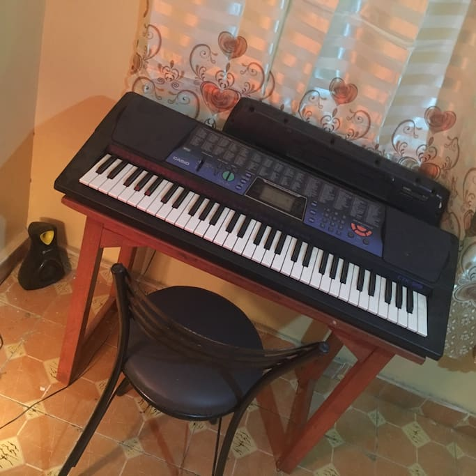 A keyboard piano in the house