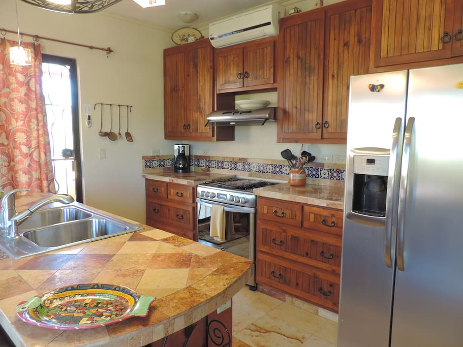 Second floor kitchen with stainless appliances. Fridge with purified water & ice
