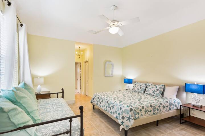 Master Bedroom with a comfortable king size bed to relax after a fun day at the beach...