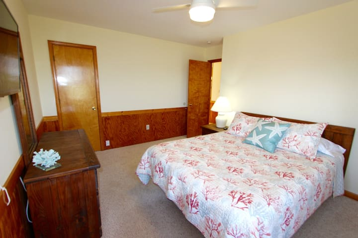 Queen Coral Bedroom with Shared Bath Access