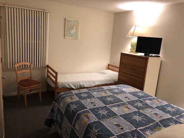 Bedroom with queen and twin beds. CTV