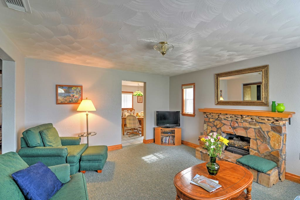 The home's interior features custom woodwork and cozy furnishings.
