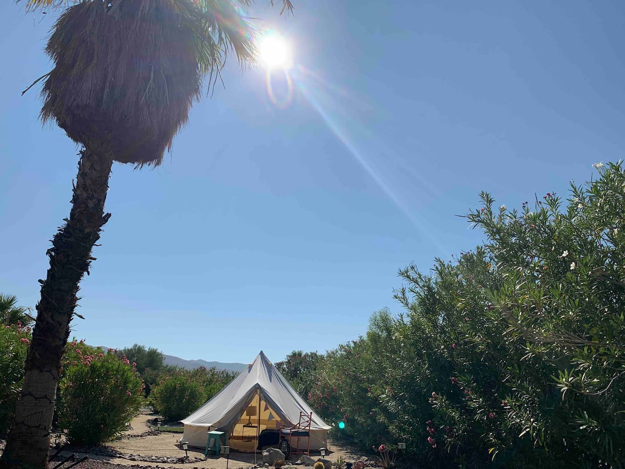 Surrounded by desert oleanders, this glampsite feels like its own private compound, yet civilization is close by!  Enjoy the breathtaking mountain views,  or gaze at the stars, you'll have everything you need for a quiet, rejuvenating get away!