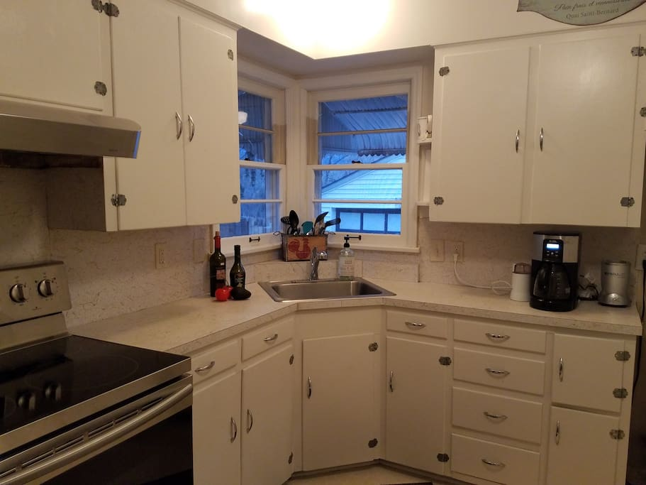 Kitchen with brand-new electric range and oven