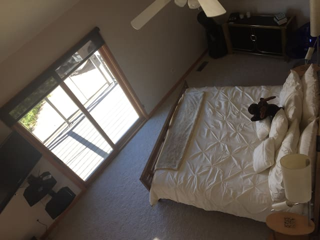 Master Bedroom with Lake View.  The loft overlooks the master bedroom