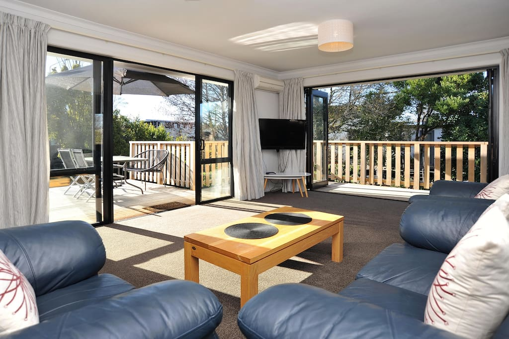 The sunny living area opens onto the deck