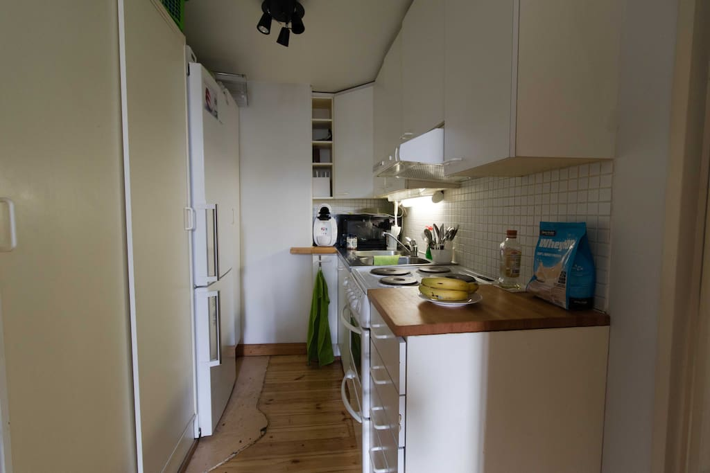 The kitchen area is light and even though it is small, well planned enough to be usable.